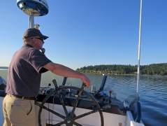 Photo of Captain Tom steering the boat