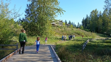 Photo of people walking on trails at Sehmel Homestead Park