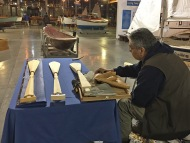 Photo of Puyallup Tribal member carving paddles.