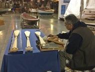 Photo of Puyallup Tribal member carving paddles.